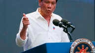 Philippine President Rodrigo Duterte gestures during his address to a Filipino business sector in suburban Pasay city south of Manila, Philippines, Oct. 13, 2016.