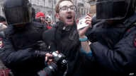 FILE - Riot policemen detain a journalist during a protest rally in St. Petersburg, Russia, March 26, 2017.