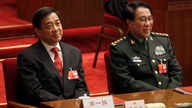 FILE- DXu Caihou, vice chairman of the CPC Central Military Commission, right, and Chongqing party secretary Bo Xilai attend the closing session of the National People's Congress in Beijing's Great Hall of the People in China, March 14, 2012.