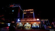 FILE - A restaurant, hotel and casino is seen in Sihanoukville, Cambodia, Sept. 27, 2017.
