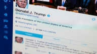 FILE- President Donald Trump's Twitter feed is photographed on a computer screen in Washington. April 3, 2017.