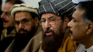 FILE - Pakistani religious cleric, Sami-ul-Haq, second right, addresses a news conference with, Hameed Gul, former chief of Pakistan's intelligence, left, in Islamabad, Pakistan.