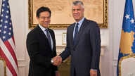 Kosovo's president Hashim Thaci, right, shakes hands with Hoyt Brian Yee, Deputy Assistant Secretary for European and Eurasian Affairs, responsible for U.S. relations with the countries of Central Europe and South Central Europe, Oct. 25, 2017, in Ko