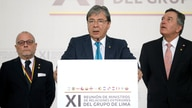 Colombia's Foreign Affairs Minister Carlos Holmes Trujillo reads the final statement after a meeting of the Lima Group in Bogota, Colombia, Feb. 25, 2019.