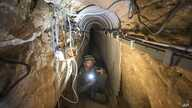 An Israeli army officer shows journalists a tunnel allegedly used by Palestinian militants for cross-border attacks from Gaza into Israel, July 25, 2014.