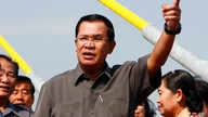 """FILE - Cambodian Prime Minister Hun Sen, delivering a speech in Phnom Penh in January, has called for the country's new National Election Commitee to be independent, saying that it does """"not need to come back and seek guidance from the parties anymor"""