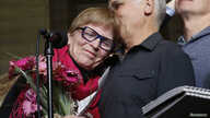 Lee Carter, whose mother had challenged Canada's assisted-suicide ban and  traveled to Switzerland to end her life in 2010. embraces her husband, Hollis Johnson, while speaking to journalists at the Supreme Court of Canada in Ottawa, Feb. 6, 2015.