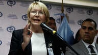 FILE - Venezuela's chief prosecutor Luisa Ortega Diaz talks to the media during a news conference in Caracas, Venezuela May 24, 2017.