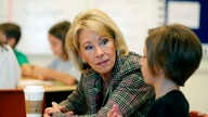 Education Secretary Betsy DeVos visits a classroom at the Edward Hynes Charter School in New Orleans, Oct. 5, 2018.