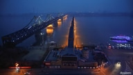 Lights are turned on on the Friendship and the Broken bridges over the Yalu River connecting the North Korean town of Sinuiju and Dandong in China's Liaoning province, March 30, 2017.