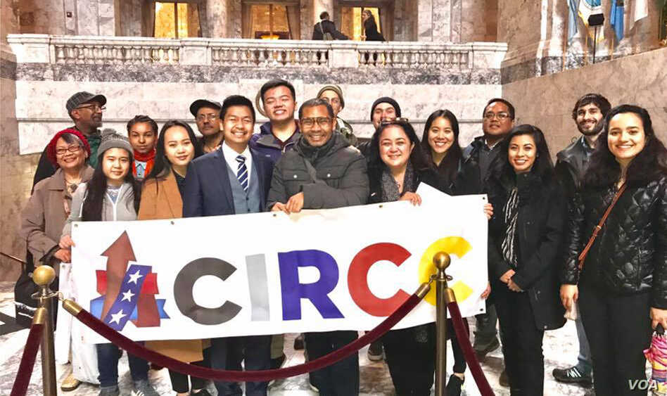 Sameth Mell stands alongsde with members of the Coalition of Immigrants, Refugees, and Communities of Color (CIRCC) in Olympia, Washington, on Legislative Day. (Courtesy of Sameth Mell)