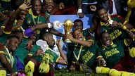 Cameroon players celebrate with the trophy after winning the African Cup of Nations final soccer match between Egypt and Cameroon at the Stade de l'Amitie, in Libreville, Gabon, Sunday, Feb. 5, 2017. Cameroon won 2-1.