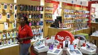 A worker walks past cell phone accessories at a Vodacom shop in Johannesburg February 4, 2015.