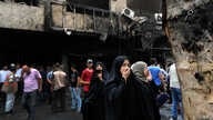 Iraqi women wait to hear about family members who went missing after a car bomb hit Karada, a busy shopping district in the center of Baghdad, Iraq, July 3, 2016.
