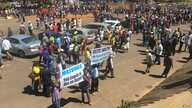 """Some members of Zanu PF party marched in Harare chanting songs to show support of first lady Grace Mugabe had a placard written """"Gabriella Engels is not an angel."""""""