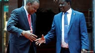Kenya's President Uhuru Kenyatta (L) shakes hands with opposition leader Raila Odinga of the National Super Alliance (NASA) coalition  following a joint news conference, at the Harambee house office in Nairobi, Kenya March 9, 2018.