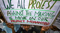 A Muslim man holds up a placard during a protest against against the anti-Islam film, in Jammu, India September 21, 2012.