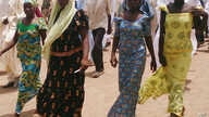 Four girls returned to the families after gumen kidnapped more than 200 girls from a northern Nigeria school.