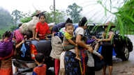 FILE - More than 4,000 ethnic Karen have abandoned a camp and villages in eastern Burma to seek refuge in Thailand following government attacks on ethnic insurgents.