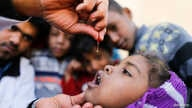 A girl is given vitamin A drops during a house-to-house vaccination campaign in Sanaa, Yemen February 20, 2017.