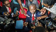 """Vital Kamerhe, President of the opposition Citizen Front (Front Citoyen, UNC) party (C) speaks to the media during the opening of a Congolese """"National Dialogue"""" in the Democratic Republic of Congo's capital Kinshasa, Sept. 1, 2016."""