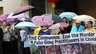 FILE - Demonstrators with the organization End the Persecution of Falun Gong Practitioners in China protest outside the Chinese Consulate in Los Angeles, Feb. 15, 2012.
