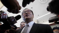 FILE - Sam Rainsy, President of the Cambodia National Rescue Party (CNRP), speaks to media after a meeting at the National Assembly in central Phnom Penh.