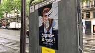 Campaign poster, like many in Paris, defaced Saturday, May 6, 2017.  France's election has been marked by dissatisfaction with both candidates and deep anti-establishment sentiments. (Photo: L. Ramirez/VOA)
