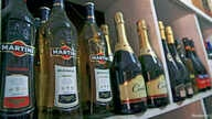 File - Bottles of alcohol are displayed in a liquor shop at Wuse Market in Abuja, Nigeria.