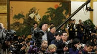 Journalists wait for a meeting before China's President Xi Jinping and other new Politburo Standing Committee members arrive at the Great Hall of the People in Beijing, Oct.  25, 2017.