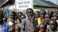 Refugees listen as U.N. High Commissioner for Refugees Filippo Grandi speaks during a visit to a transit center for South Sudanese refugees in the remote northwestern district of Adjumani, near the border with South Sudan, in Uganda, Aug. 29, 2016.