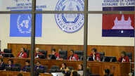 Extraordinary Chambers in the Courts of Cambodia, court officers of the U.N.-backed war crimes tribunal are seen through windows during a hearing of former Khmer Rouge top leaders in Phnom Penh, Cambodia, (File photo)..