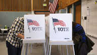 Voters fill in their ballots as they vote in the U.S. midterm elections at a polling place in Westminster, Colorado, Nov. 4, 2014.