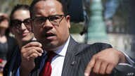 U.S. Rep. Keith Ellison (D-MN) (R) speaks during a news conference in front of the Supreme Court April 13, 2016 in Washington, DC.