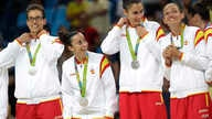Members of the Spain basketball team celebrate with their silver medals following a women's gold medal basketball game against the United States at the 2016 Summer Olympics in Rio de Janeiro, Brazil, Aug. 20, 2016.