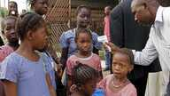 FILE In this Monday, Jan. 19, 2015 file photo, a health care worker, right, takes the temperatures of school children for signs of the Ebola virus before they enter their school in the city of Conakry, Guinea. The World Health Organization says it wi