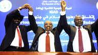 "Sudanese President Omar al-Bashir (C) raises held hands with South Sudan's President Salva Kiir Mayardit (L) and South Sudanese rebel leader Riek Machar (R) after the two South Sudanese arch-foes agreed in Khartoum, June 27, 2018, to a ""permanent"" ce"