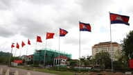 Cambodia's and Vietnam's flags are put up to welcome the state visit of Mr. Tran Dai Quang, president of the Socialist Republic of Vietnam to the Kingdom of Cambodia at Khmer-Vietnam Memorial Stupa in Phnom Penh on June 14, 2016. (Hean Socheata/VOA K