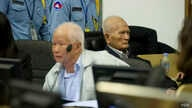 Khieu Samphan and Nuon Chea in a 2013 hearing at the Khmer Rouge tribunal. (Courtesy Image of Mark Peters/ECCC)