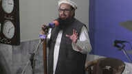 Hafiz Saeed, head of the Pakistani religious party, Jamaat-ud-Dawa, gives Friday sermon at a mosque in Lahore, Pakistan, Nov. 24, 2017.