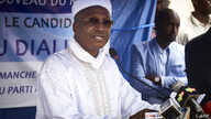 FILE - Malian entrepreneur Aliou Boubacar Diallo attends a rally in support of his candidacy for the next presidential elections in Mali, June 17, 2018, in Bamako.