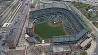 In this aerial photo, Oriole Park at Camden Yards sits empty in Baltimore, as unrest that occurred after Freddie Gray's funeral continues into a second day, April 28, 2015.