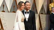 Chrissy Teigen, left, and John Legend arrive at the Oscars on Feb. 26, 2017, at the Dolby Theatre in Los Angeles.