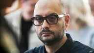 FILE - Russian theater and film director Kirill Serebrennikov waits for the start of hearings in a court in Moscow, Russia.