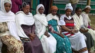 Latrines, safe delivery of babies and children's vaccinations are this Dosha army's normal discussion agenda. (VOA/Joana Mantey)