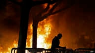FILE - A fire set by demonstrators protesting a scheduled speaking appearance by Breitbart News editor Milo Yiannopoulos burns on Sproul Plaza on the University of California, Berkeley campus, Feb. 1, 2017.