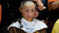 Tanya Chan wears a yellow ribbon to show support for full democratic elections in Hong Kong, Sept. 9, 2014. (Iris Tong / VOA Cantonese)