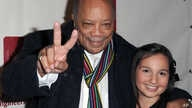 """Quincy Jones, left, and Emily Bear arrive at The Recording Academy's 4th Annual """"An Evening of Jazz"""" at The Village Recording Studios, Feb. 6, 2013 in Los Angeles."""