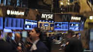 Traders work on the floor of the New York Stock Exchange in New York, December 26, 2012.