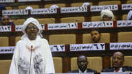 A Sudanese parliament member speaks during a National Assembly emergency session discussing a state of emergency declared by the president following anti-government protests, on March 11, 2019.